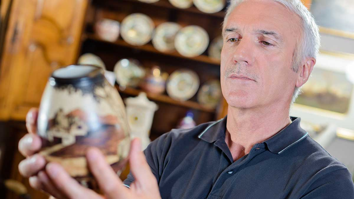 man looking at antiques
